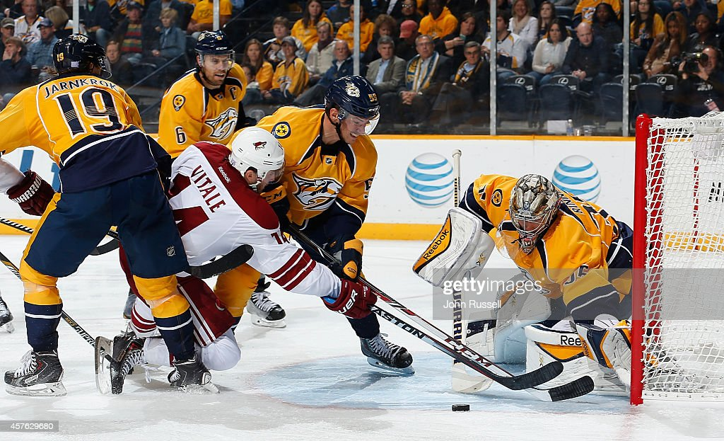Joe Vitale #14 of the Arizona Coyotes has his shot blocked by goalie Pekka Rinne #35 as Roman Josi #59 of the Nashville Predators defends at Bridgestone Arena on October 21, 2014 in Nashville, Tennessee.