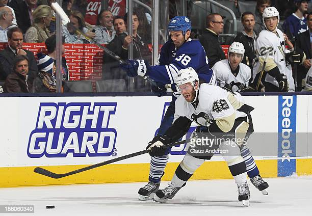 Joe Vitale of the Pittsburgh Penguins battles against Frazer McLaren of the Toronto Maple Leafs during an NHL game at the Air Canada Centre on...