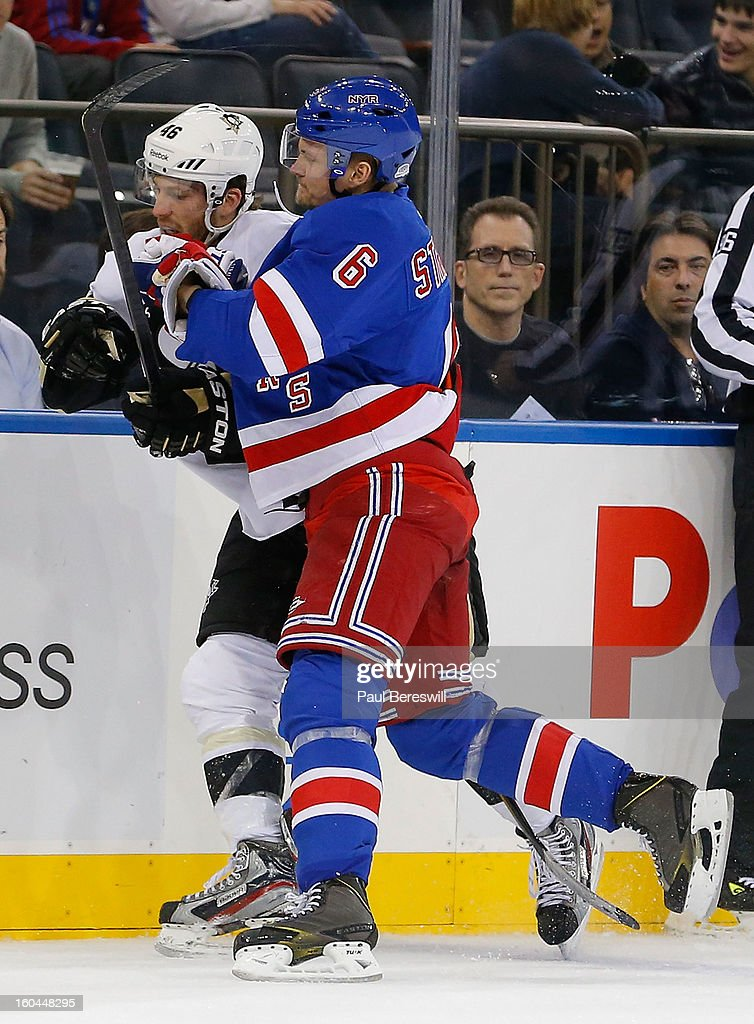 Joe Vitale #46 of the Pittsburgh Penguins is checked by Anton Stralman #6 of the New York Rangers in the third period of an NHL hockey game at Madison Square Garden on January 31, 2013 in New York City.