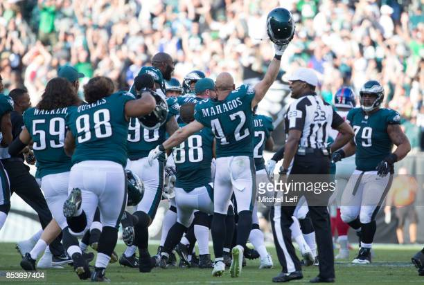 Joe Walker Elijah Qualls Derek Barnett Trey Burton and Chris Maragos of the Philadelphia Eagles celebrate at the end of the game against the New York...
