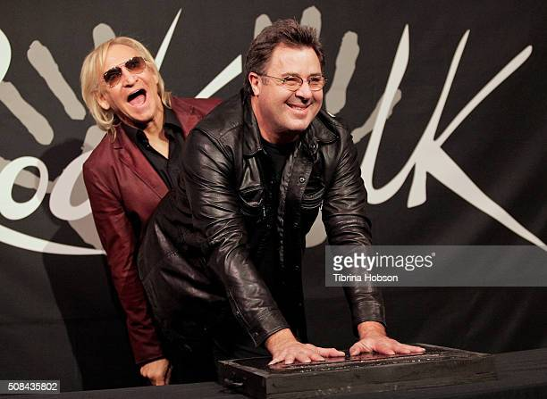Joe Walsh and Vince Gill attend Vince Gill's Induction into Guitar Center's RockWalk at Guitar Center on February 4 2016 in Hollywood California