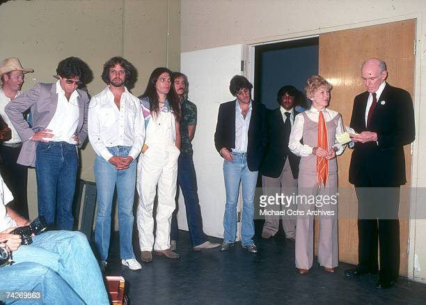 Joe Walsh Don Felder Timothy B Schmit Alan Cranston Don Henley Glenn Frey and Norma Weintraub attend an event in 1980