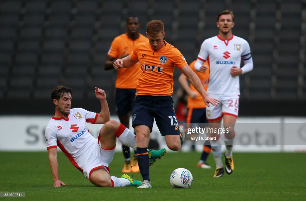 Joe Walsh of Milton Keynes Dons and Eoin Doyle of Oldham Athletic in action during the Sky Bet League One match between Milton Keynes Dons and Oldham Athletic at StadiumMK on October 21, 2017 in Milton Keynes, England.