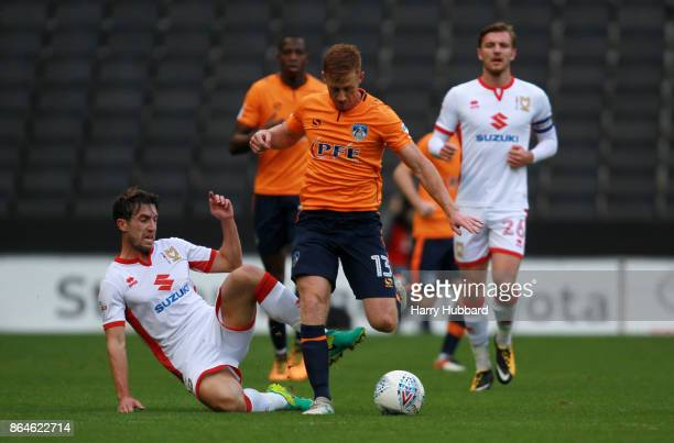 Joe Walsh of Milton Keynes Dons and Eoin Doyle of Oldham Athletic in action during the Sky Bet League One match between Milton Keynes Dons and Oldham...