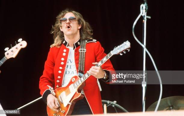 Joe Walsh of The Eagles performs on stage wearing a vintage military jacket at Wembley Stadium London 14th September 1974