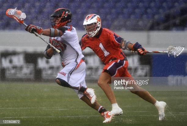 Joe Walters of Hamilton Nationals looks to make a check against the Denver Outlaws in the first quarter at NavyMarine Corps Memorial Stadium on...