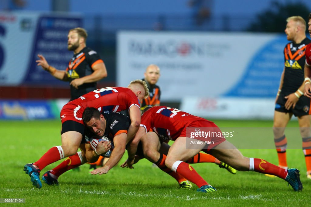Joe Wardle of Castleford Tigers is tackled during the Roger Millward Trophy match between Hull KR and Castleford Tigers as part of the Betfred Super League at KCOM Stadium on June 1, 2018 in Hull, England.