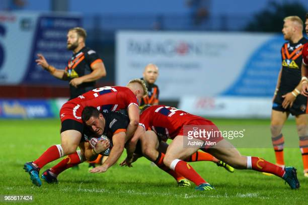 Joe Wardle of Castleford Tigers is tackled during the Roger Millward Trophy match between Hull KR and Castleford Tigers as part of the Betfred Super...