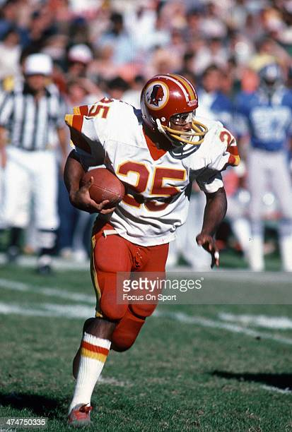 Joe Washington of the Washington Redskins carries the ball against the Detroit Lions during an NFL football game October 23 1983 at RFK Stadium in...