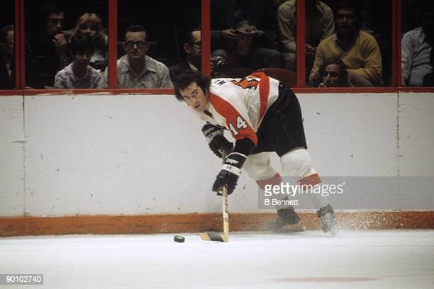 Joe Watson of the Philadelphia Flyers skates with the puck in a circa 1970's game at the Spectrum in Philadelphia Pennsylvania