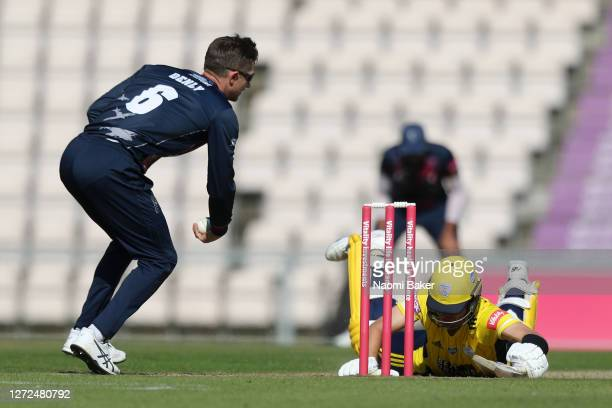 Joe Weatherley of Hampshire slides into the creases ahead of Joe Denly of Kent during the T20 Vitality Blast 2020 between Hampshire and Kent...