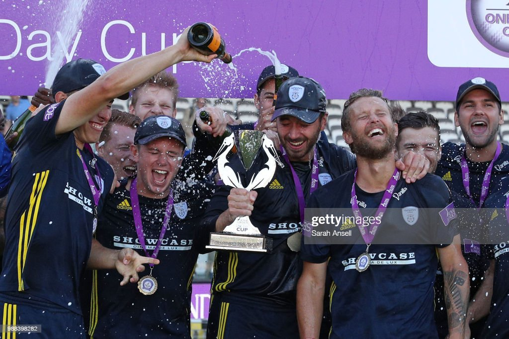 Joe Weatherley pours champagne on to captain James Vince's head as Hampshire celebrate winning the Royal London One-Day trophy at the end of the Royal London One-Day final match between Kent and Hampshire on June 30, 2018 in London, England. (Photo by Sarah Ansell/Getty Images).