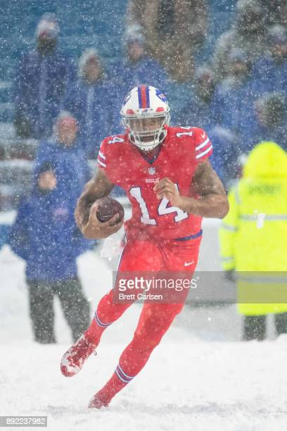 Joe Webb of the Buffalo Bills carries the ball during overtime against the Indianapolis Colts at New Era Field on December 10 2017 in Orchard Park...
