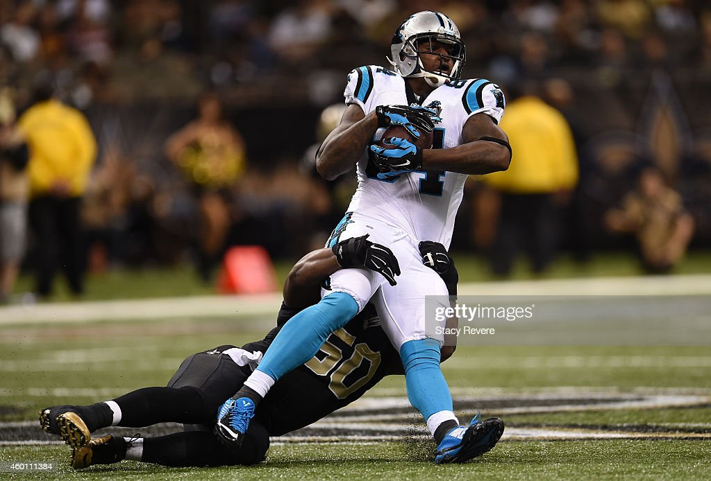 Joe Webb #14 of the Carolina Panthers is tackled by Curtis Lofton #50 of the New Orleans Saints during the second quarter at Mercedes-Benz Superdome on December 7, 2014 in New Orleans, Louisiana.