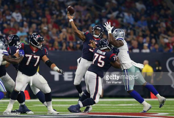 Joe Webb of the Houston Texans throws a pass under pressure by Dorance Armstrong of the Dallas Cowboys in the first half of the preseason game at NRG...