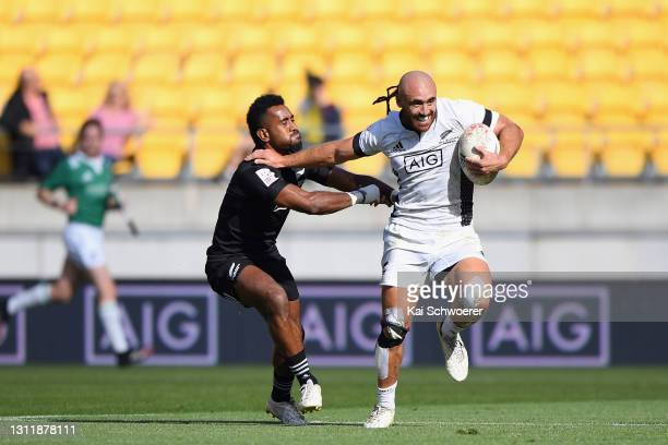 Joe Webber makes a break during the match between the All Blacks Sevens Black and All Blacks Sevens White at Sky Stadium, on April 11 in Wellington,...