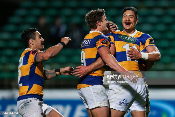 Joe Webber of Bay of Plenty celebrates his try with Lalakai Foketi Richard Judd and Terrence Hepetema during the round four Mitre 10 Cup match...