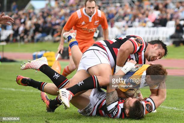 Joe Webber of Bay of Plenty is tackled just short of the try line during the round six Mitre 10 Cup match between Bay of Plenty and Counties Manukau...