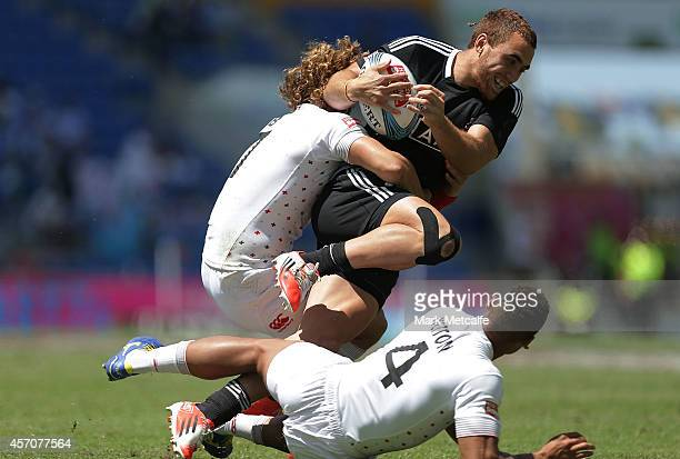 Joe Webber of New Zealand is tackled by Dan Norton and Dan Bibby of England during the 2014 Gold Coast Sevens Cup quarterfinal match between New...