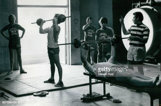 Joe Weiss, student teacher from the University of Denver, instructs boys at Cherry Creek West Junior High in weight lifting in new program that...