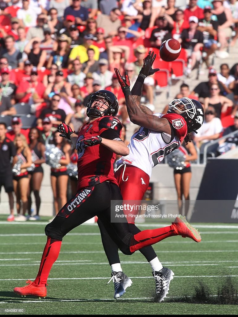 Joe West #85 of the Calgary Stampeders makes a catch against Eric Fraser #7 of the Ottawa Redblacks during a CFL game at TD Place Stadium on August 24, 2014 in Ottawa, Ontario, Canada.