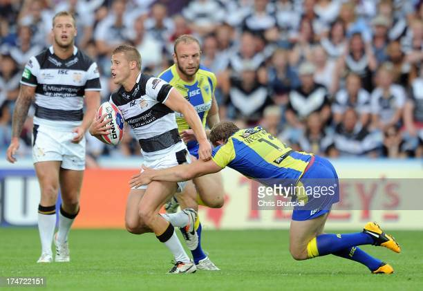 Joe Westerman of Hull FC is tackled by Ben Westwood of Warrington Wolves during the Tetley's Challenge Cup Semi Final between Hull FC and Warrington...