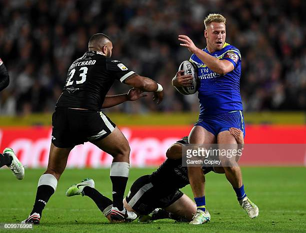 Joe Westerman of Warrington gets past Frank Pritchard of Hull during the First Utility Super League match between Hull FC and Warrington Wolves at...
