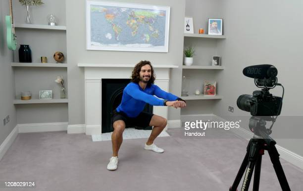 Joe Wicks, aka The Body Coach, teaches the UK's school children physical education live via YouTube on March 23, 2020 from his home in London,...