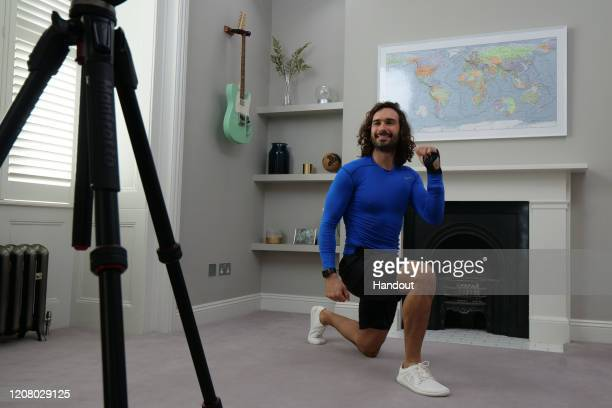 Joe Wicks aka The Body Coach teaches the UK's school children physical education live via YouTube on March 23 2020 from his home in London England...