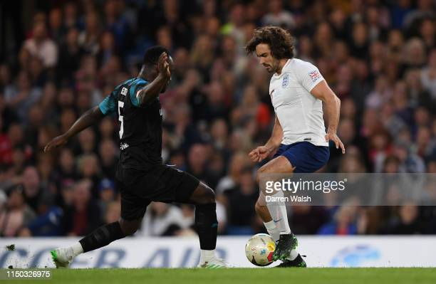 Joe Wicks is tackled by Michael Essien during the Soccer Aid for UNICEF 2019 England v Soccer Aid World XI at Stamford Bridge on June 26th 2019 in...