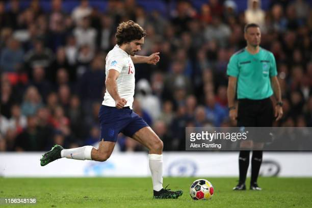 Joe Wicks of England takes a penalty during the 2019 Soccer Aid for UNICEF match between England and Soccer Aid World XI at Stamford Bridge on June...