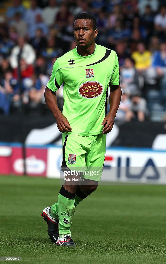Joe Widdowson of Northampton Town in action during the npower League Two match between Rochdale and Northampton Town at Spotland Stadium on August 18, 2012 in Rochdale, England.