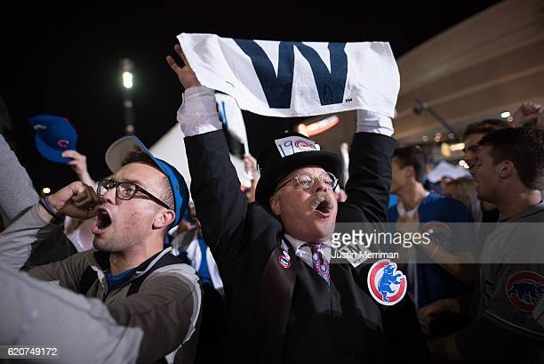 Joe Wiegand of Colorado Springs Colo a Theodore Roosevelt impersonator and selfproclaimed Cubs fan celebrates after the Chicago Cubs defeated the...