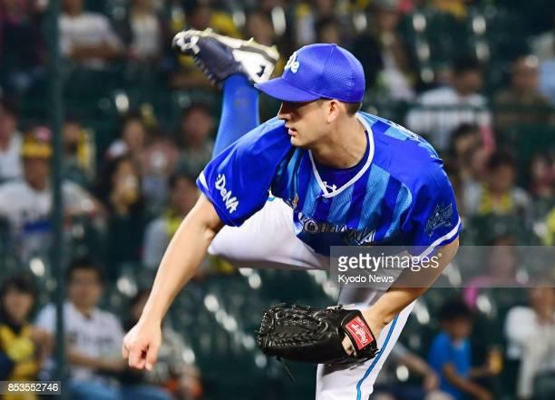 Joe Wieland of the DeNA BayStars pitches against the Hanshin Tigers at Koshien Stadium in Nishinomiya Hyogo Prefecture on Sept 25 2017 Wieland threw...