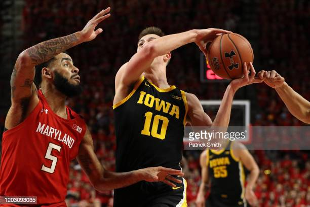 Joe Wieskamp of the Iowa Hawkeyes dribbles past Eric Ayala of the Maryland Terrapins during the first half at Xfinity Center on January 30, 2020 in...