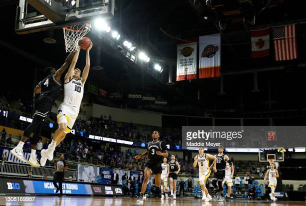 Joe Wieskamp of the Iowa Hawkeyes drives to the basket as Oscar Frayer of the Grand Canyon Antelopes defends during the second half in the first...