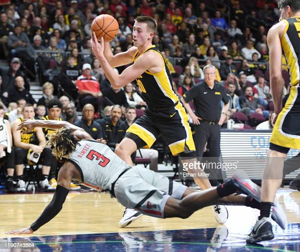 Joe Wieskamp of the Iowa Hawkeyes steals the ball from Jahmi'us Ramsey of the Texas Tech Red Raiders during the 2019 Continental Tire Las Vegas...