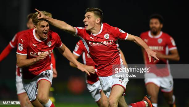 Joe Williams of Barnsley celebrates scoring his team's third goal during the Sky Bet Championship match between Burton Albion and Barnsley at Pirelli...