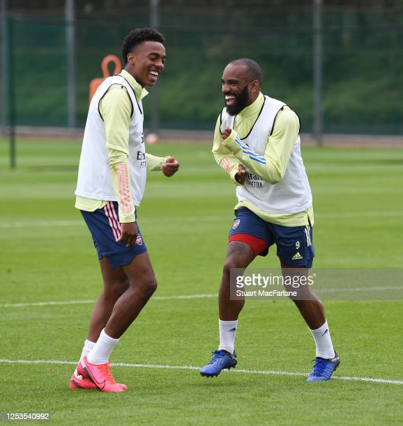 Joe WIllock and Alex Lacazette of Arsenal during a training session at London Colney on June 30, 2020 in St Albans, England.