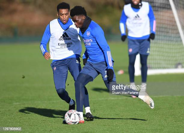 Joe Willock and Bukayo Saka of Arsenal during a training session at London Colney on January 22, 2021 in St Albans, England.