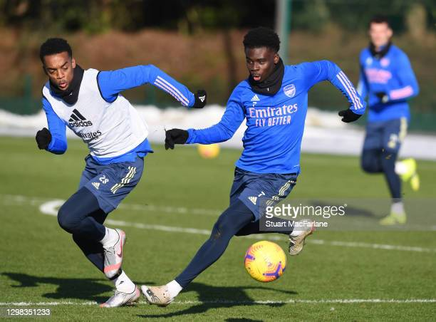 Joe Willock and Bukayo Saka of Arsenal during a training session at London Colney on January 25, 2021 in St Albans, England.