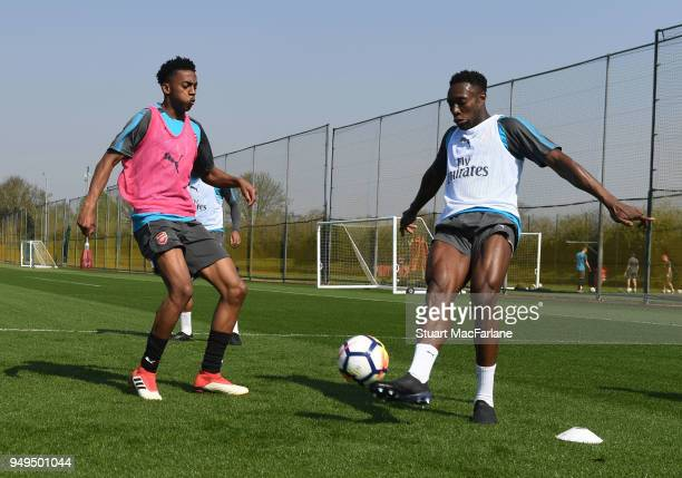 Joe Willock and Danny Welbeck of Arsenal during a training session at London Colney on April 21 2018 in St Albans England