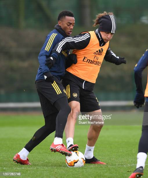 Joe Willock and David Luiz of Arsenal during a training session at London Colney on February 19 2020 in St Albans England