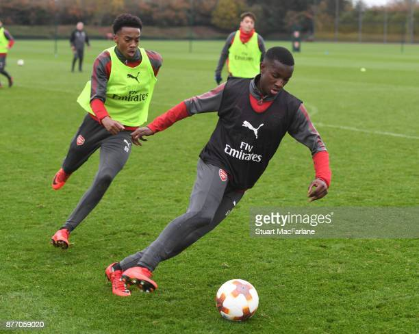 Joe Willock and Eddie Nketiah of Arsenal during a training session at London Colney on November 21 2017 in St Albans England