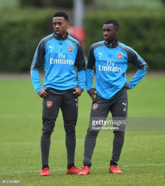 Joe Willock and Eddie Nketiah of Arsenal during a training session at London Colney on January 29 2018 in St Albans England