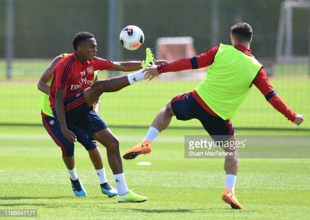Joe Willock and Granit Xhaka of Arsenal during a training session at London Colney on August 21, 2019 in St Albans, England.