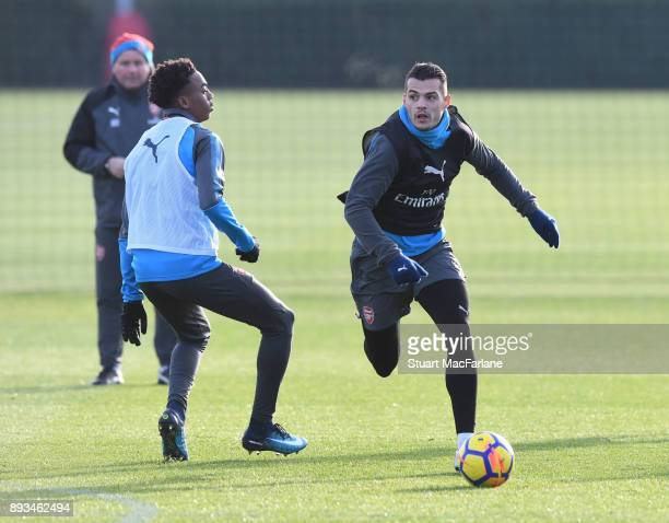 Joe Willock and Granit Xhaka of Arsenal during a training session at London Colney on December 15 2017 in St Albans England