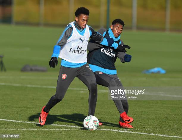 Joe Willock and Jeff ReineAdelaide of Arsenal during a training session at London Colney on December 18 2017 in St Albans England