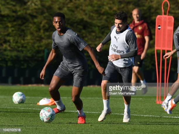 Joe Willock and Lucas Torreria of Arsenal during a training session at London Colney on September 25 2018 in St Albans England