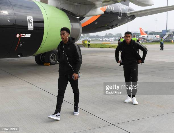 Joe Willock and Marcus McGuane of Arsenal board the plane at Luton Airport on September 27 2017 in Luton England